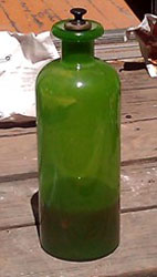 Rare green apothecary bottle, approx 18 inches tall.